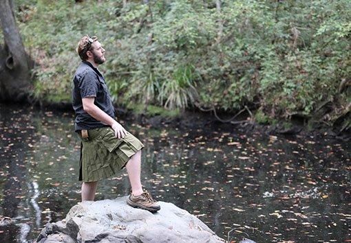 man standing on a rock wearing ozkilts kilt